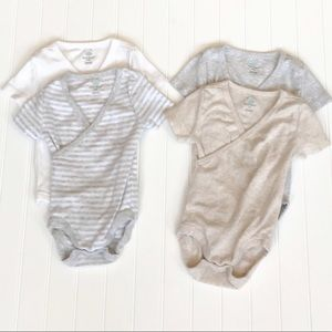 NWOT 4 Short Sleeve Baby Onesies. Size 6 -9 Months